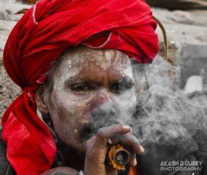 Sadhu smoking a little something something! Photo by Akash Dutt Dubey